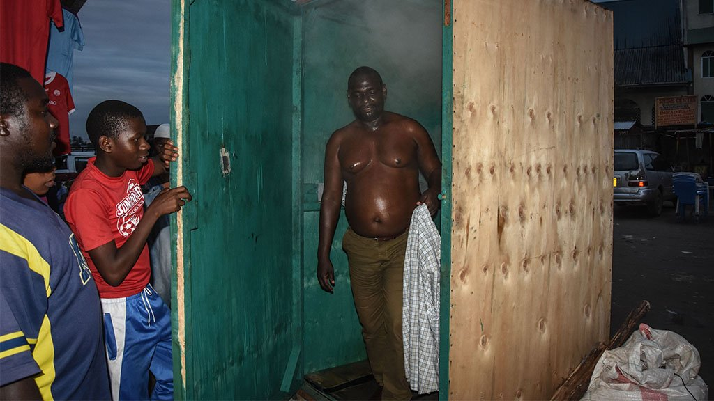 A man leaves a steam inhalation booth in Dar es Salaam, Tanzania, on 22 May, 2020