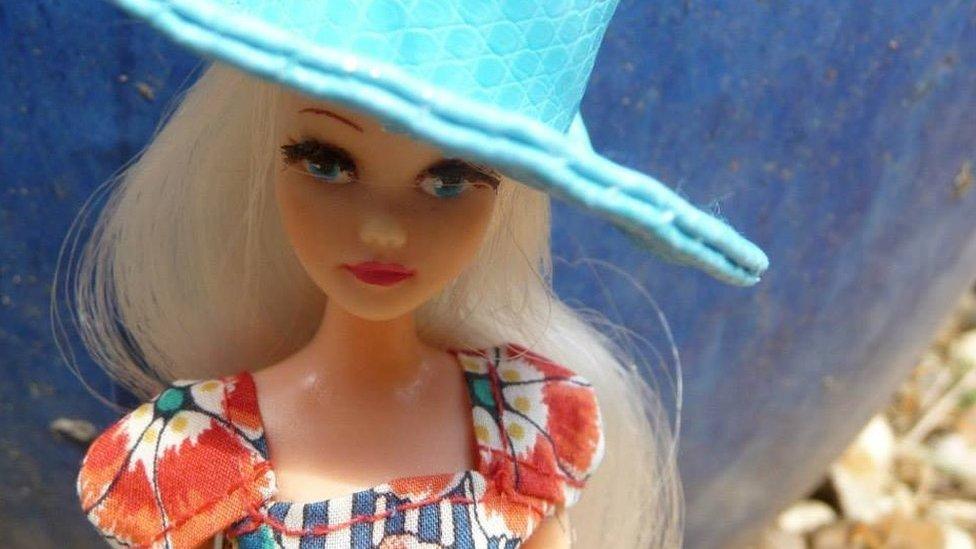 Pippa doll wearing a fancy blue hat