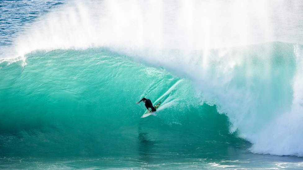 A surfer on a big wave in Sydney