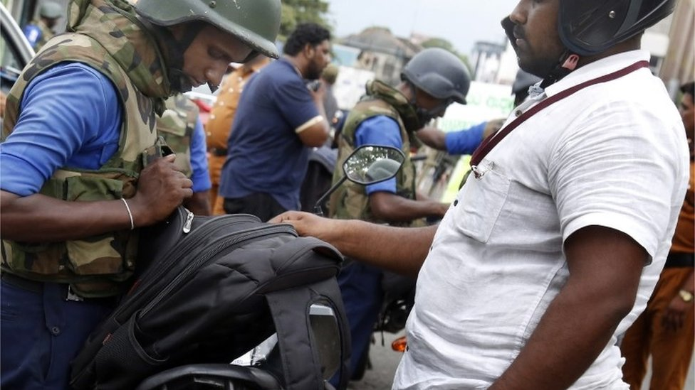 Security personnel check bags in Colombo in the aftermath of the Easter Sunday bomb attacks, 25 April 2019