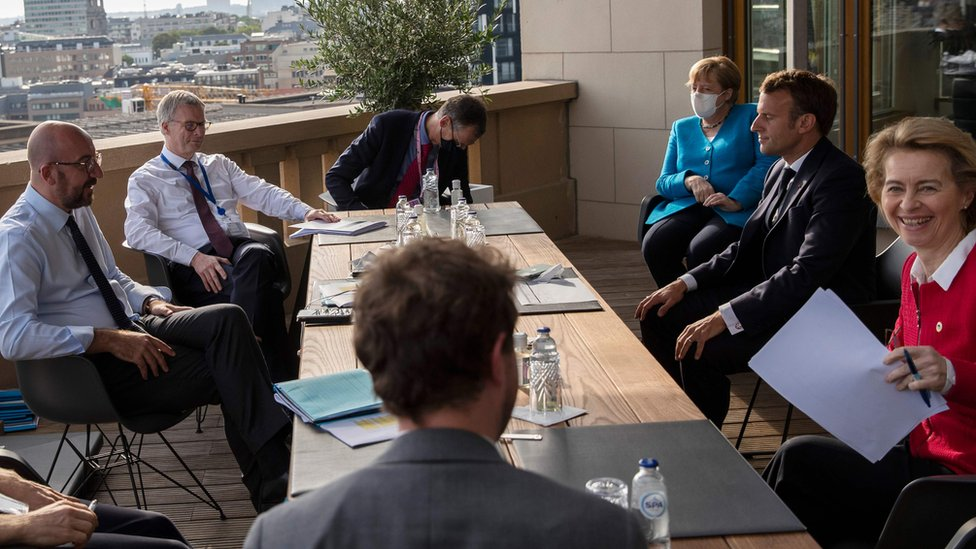 European Council President Charles Michel (L), German Chancellor Angela Merkel (3rd R), French President Emmanuel Macron (2nd R), and European Commission President Ursula von der Leyen (R) meet on the sidelines of an EU summit