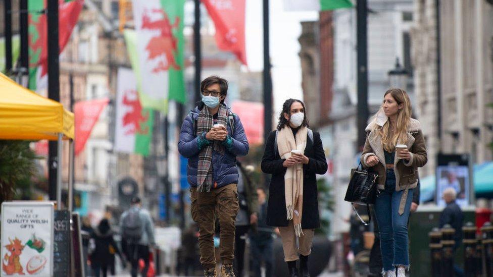 Three people walking down St Marys Street
