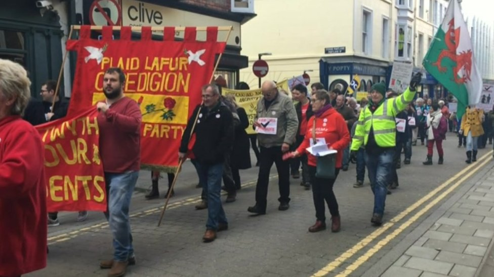 About 150 people attended a march in protest of the council's plans to close the home