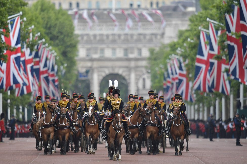 Members of The Kings Troop Royal Artillery lead the parade down the Mall back to Buckingham Palace after of the Queens Birthday Parade, Trooping the Colour