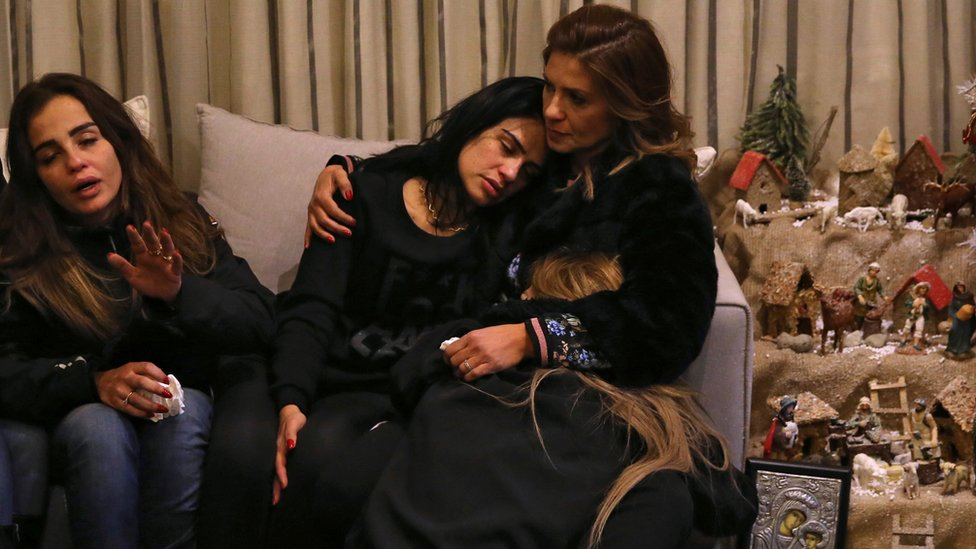 Sisters of Elias Wardini, Lebanese man killed in Istanbul attack, mourn at their house in Beirut on 1 January 2017