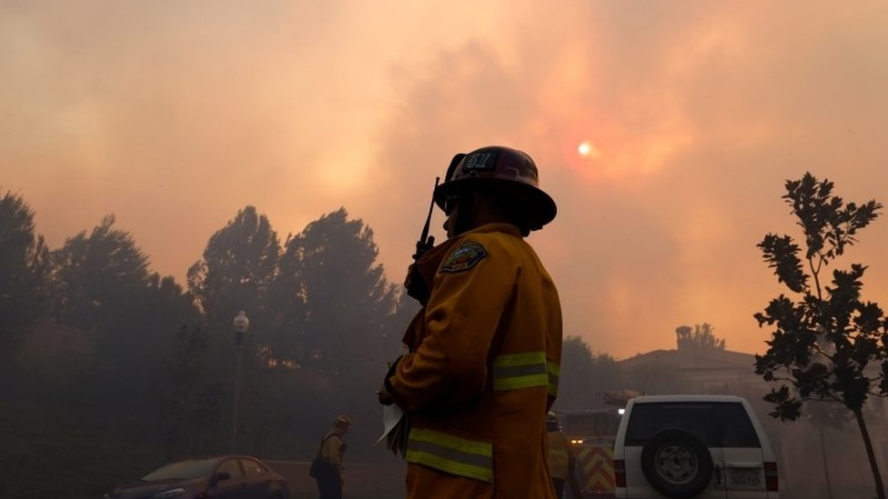 Firefighters gather as the Silverado Fire approaches, near Irvine, California