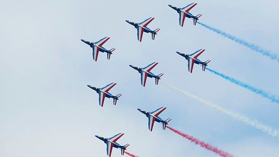 Alphajet aircrafts of the French elite acrobatic flying team 'Patrouille de France' (PAF) release smoke in the colours of the French national flag as they perform a flying display during the public days of the 51st International Paris Air Show in Le Bourget, north of Paris, on June 20, 2015