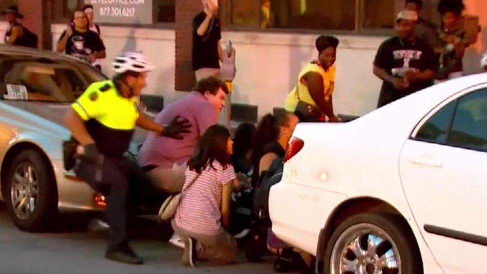 Police and pedestrians react to gunshots