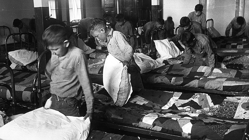 Children in a residential school dormitory in the 1950s