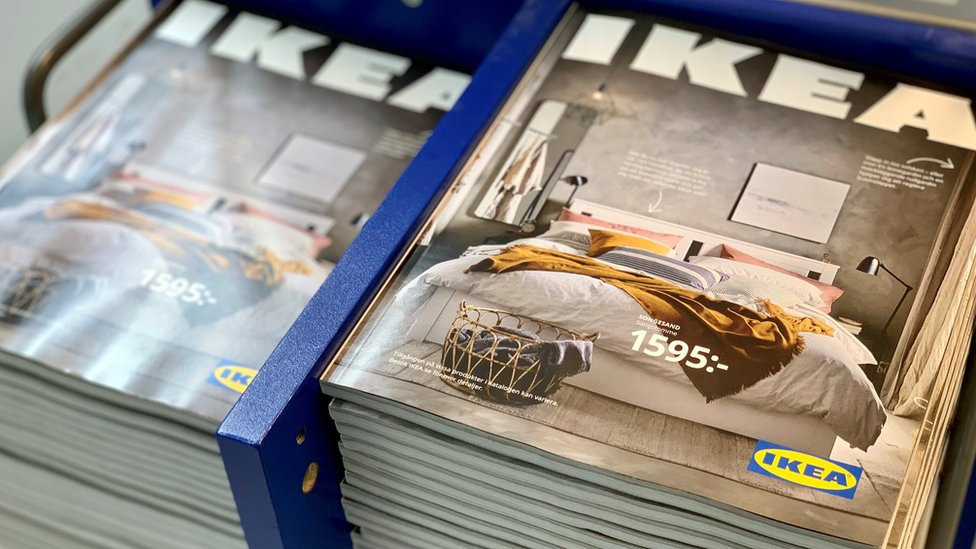 The 2021 catalogues are stacked at an IKEA store on the outskirts of Stockholm