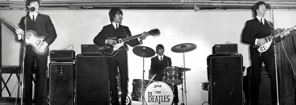 The Beatles onstage at the King's Hall in 1964