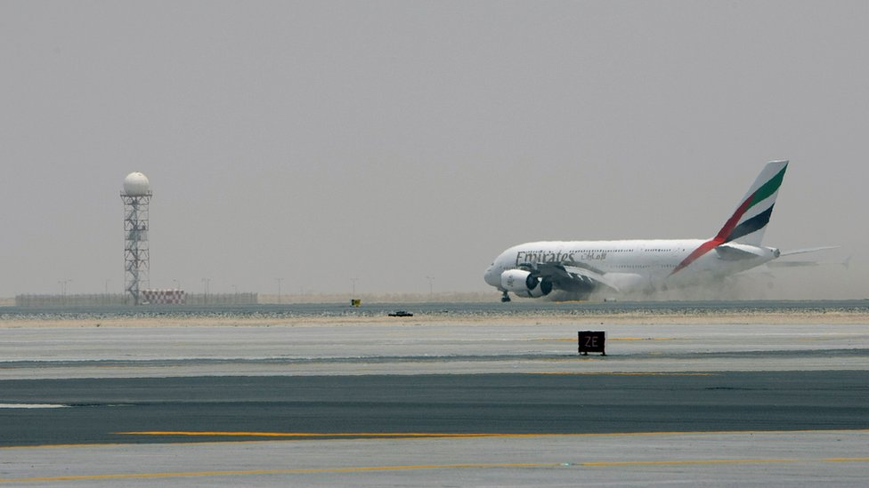 Emirates airlines plane on the runway at Dubai airport