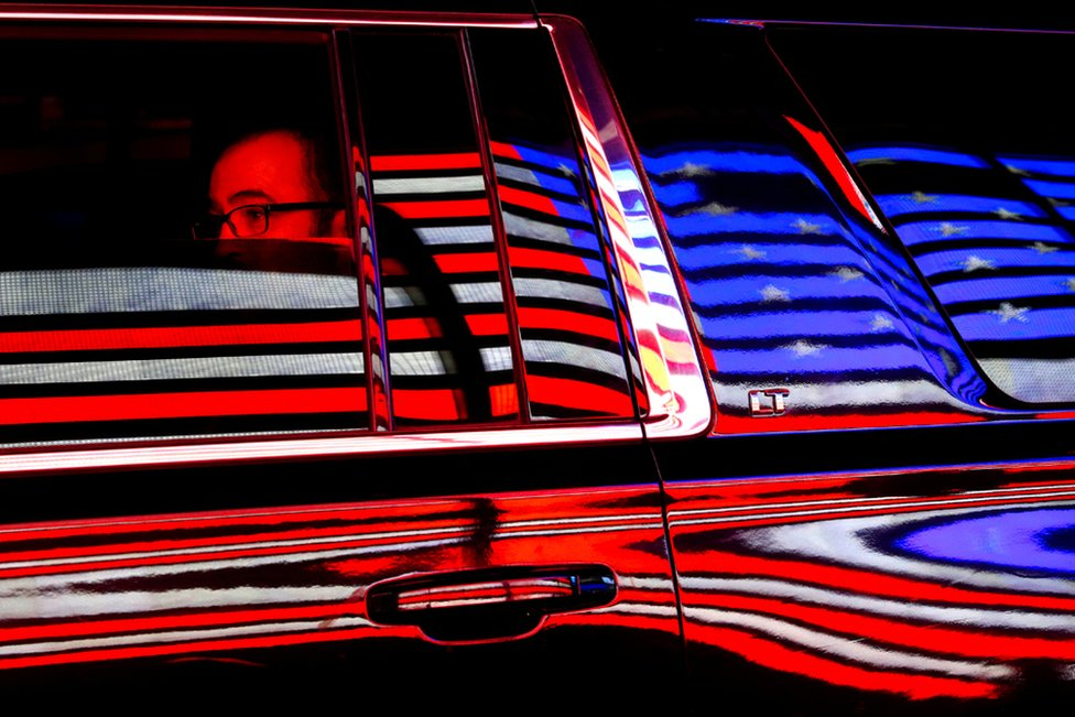 The US flag is reflected in a taxi window during the 100th New York Veterans' Day Parade.
