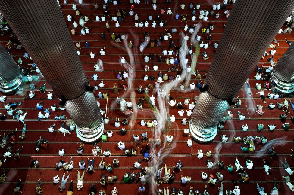 Indonesian Muslims shown shortly after Friday prayers in the month of Ramadan at Istiqlal mosque in Jakarta, Indonesia