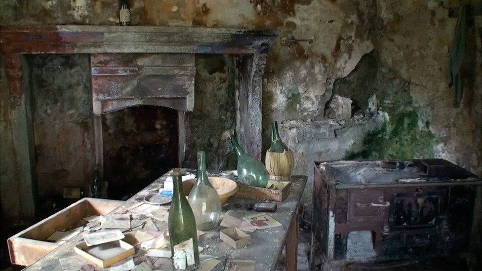 Interior of abandoned stone house in Corippo