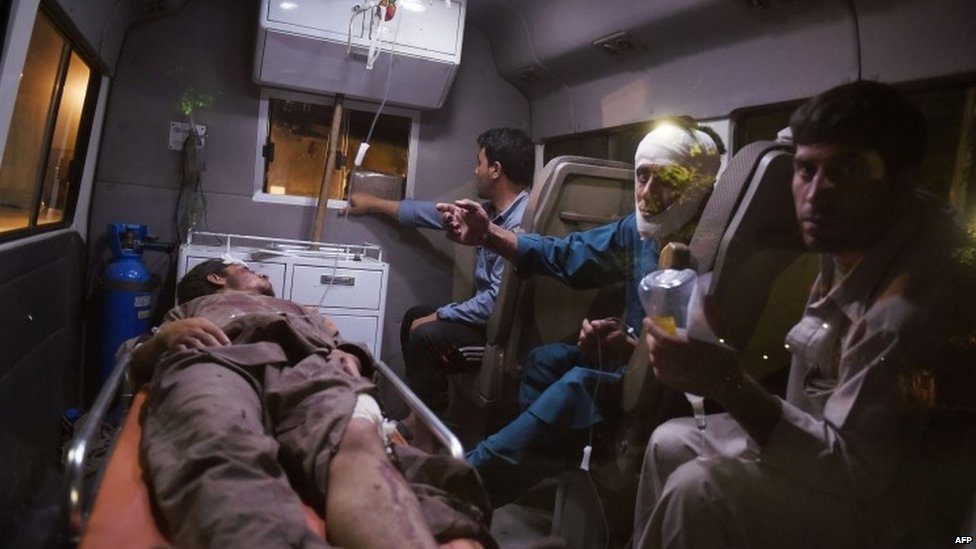 Injured Afghans are taken to hospital after the truck bomb explosion in Kabul (07 August 2015)