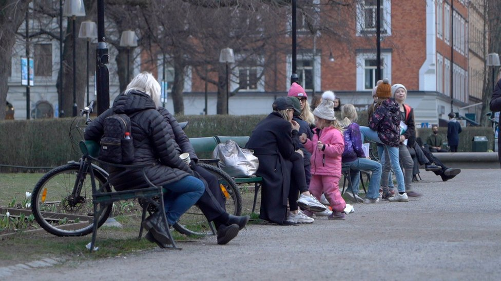 Families enjoy the fresh air in a Stockholm park