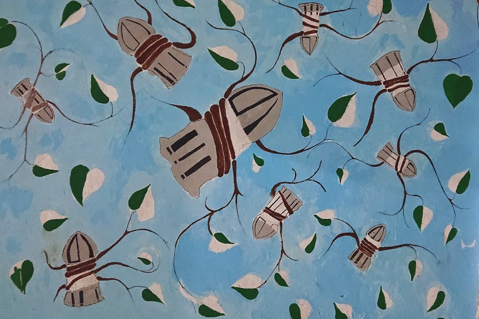A mural of bullets and plants in Khartoum, Sudan