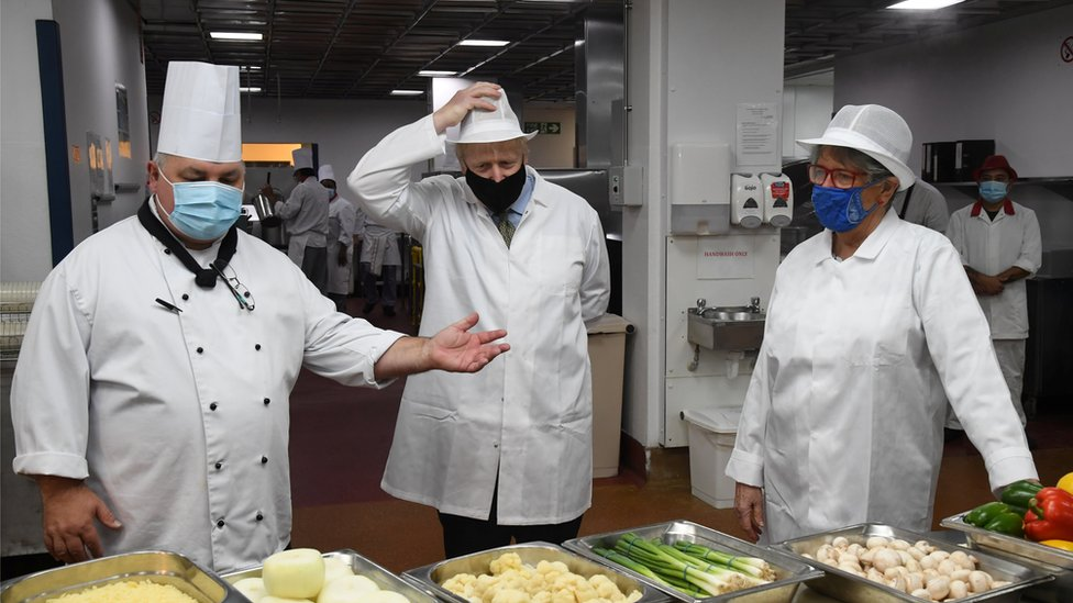 A chef at the Royal Berkshire Hospital, left, with Boris Johnson, centre, and Prue Leith, right