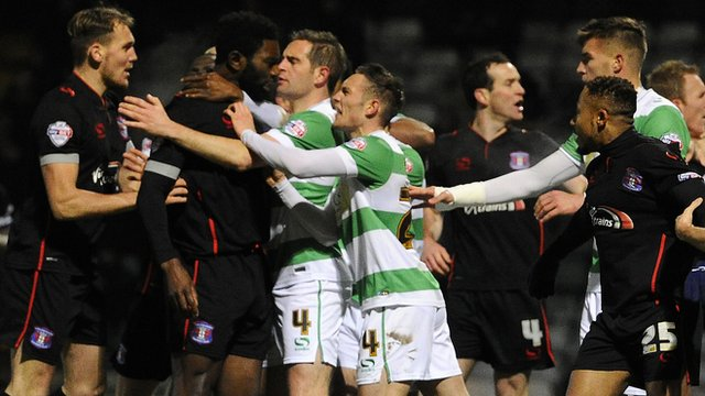 Yeovil and Carlisle players clash during their FA Cup third-round replay