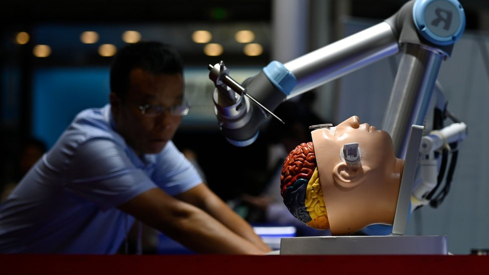 A robotic arm for brain surgery is seen at the 2019 World Robot Conference in Beijing on August 20, 2019.