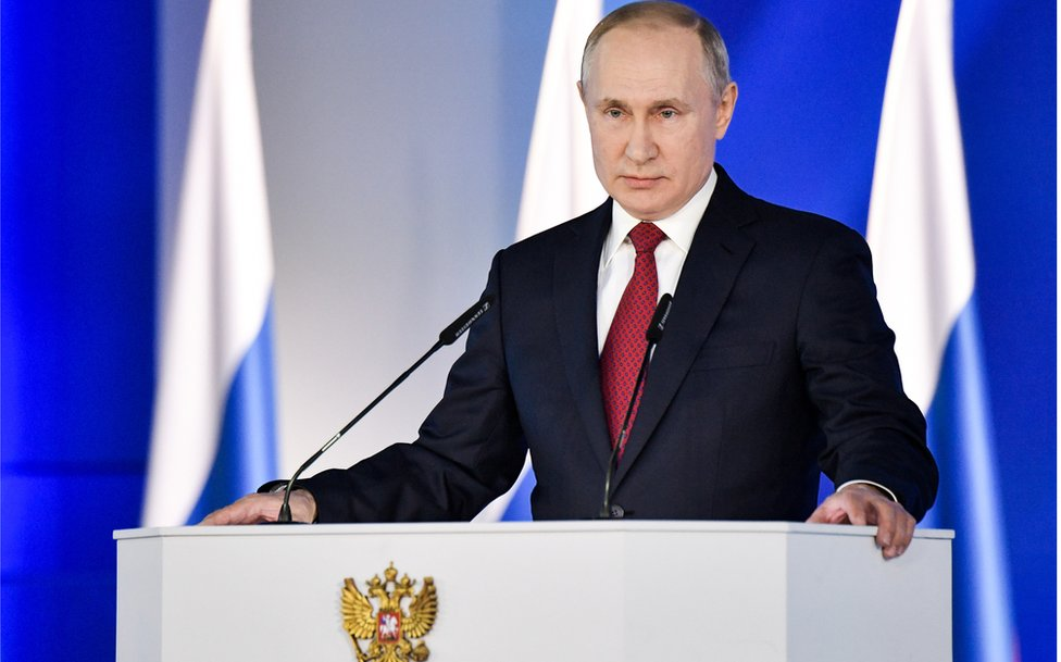 Russia's President Vladimir Putin delivers an annual address to the Federal Assembly of the Russian Federation, at Moscow's Manezh Central Exhibition Hall on 15 Jan