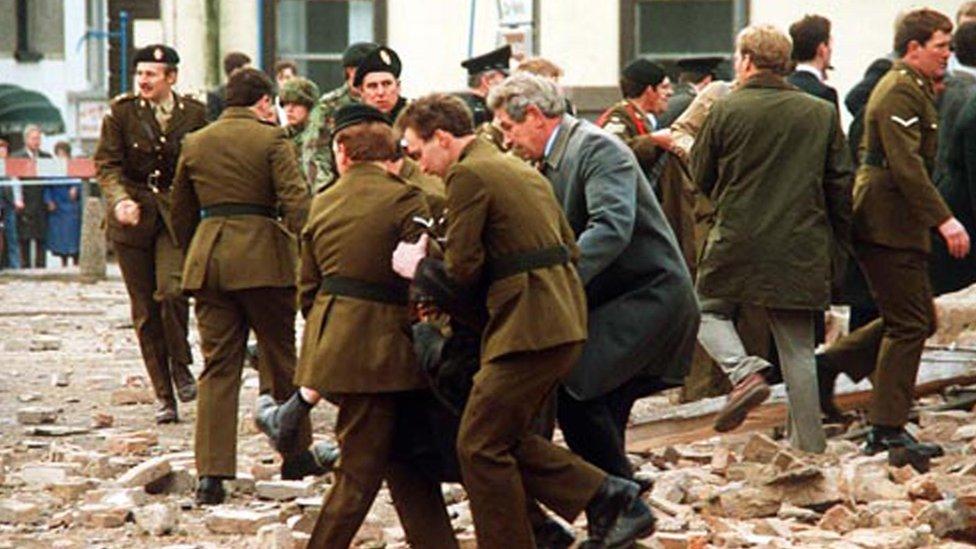 Soldiers and civilians help survivors