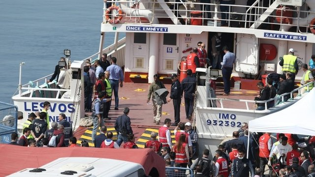 A ferry carrying migrants from Greece arrives at Dikili in Turkey