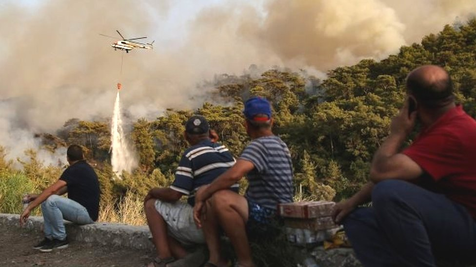 A helicopter is deployed against a fire near Marmaris