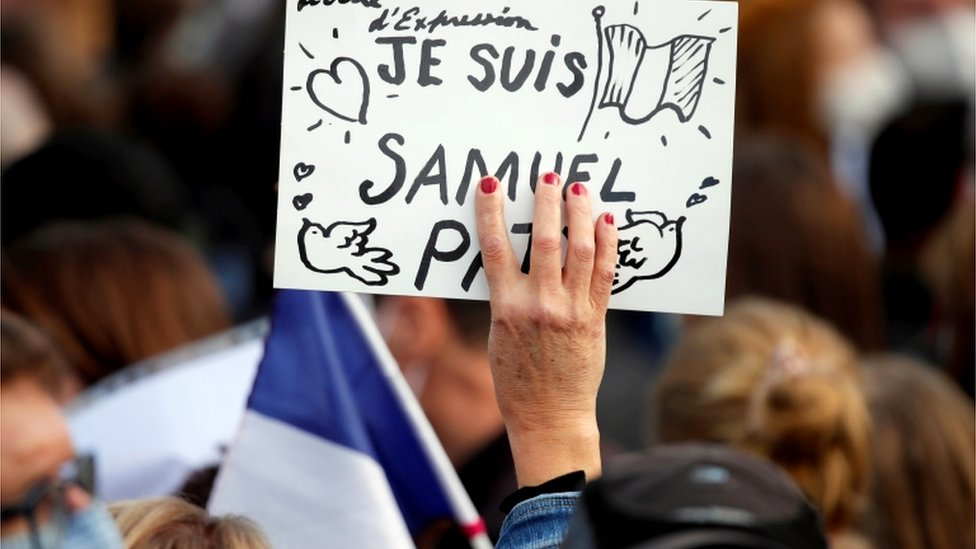 People gather at the Place de la Republique in Paris, to pay tribute to Samuel Paty, the French teacher who was beheaded