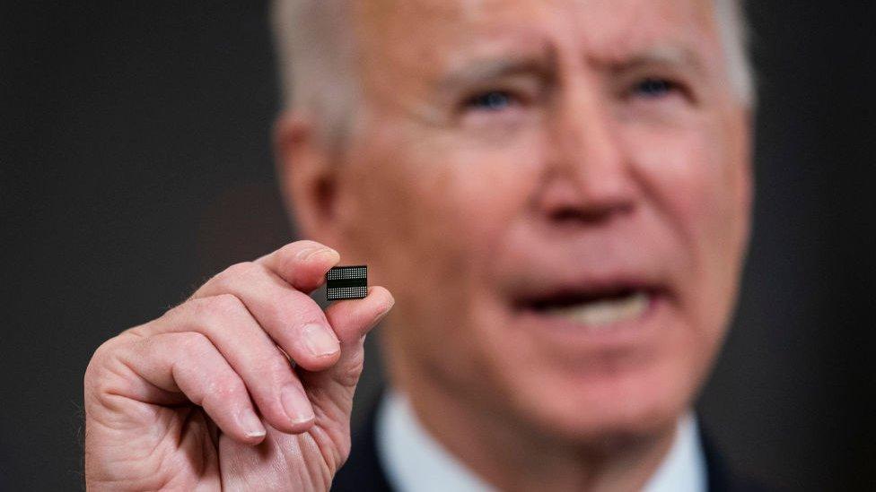 President Biden holds chip