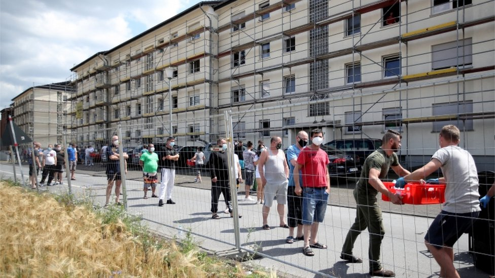 Authorities hand out food supplies to quarantined employees of the Tönnies meatpacking plant