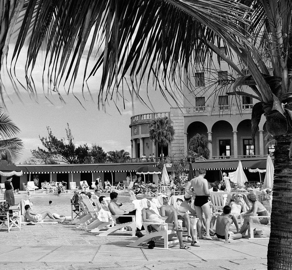 Tourists at the swimming pool of Havana's Hotel Nacional