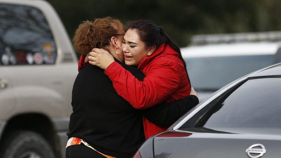 Vanessa Flores (R) embraces another woman after she leaves the locked down Veterans Home of California during an active shooter turned hostage situation on March 9, 2018 in Yountville, California.