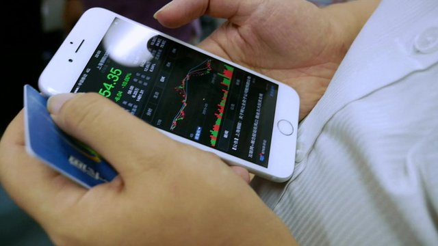 Smartphone displaying stock prices