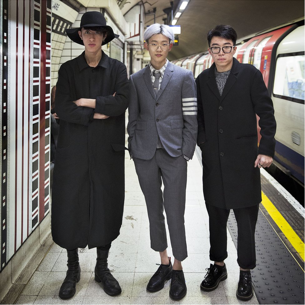 Three people posing on the underground system
