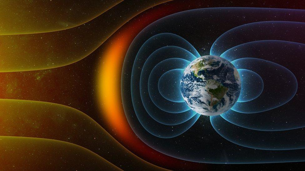 Model radiasi angkasa luar dan angin matahari di sekitar Bumi.