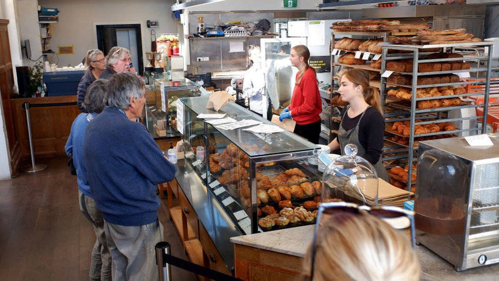 Daily Bread cafe and bakery in Pt Chev welcomes customers back inside while maintaining social distancing and hygiene measures on May 16, 2020 in Auckland, New Zealand