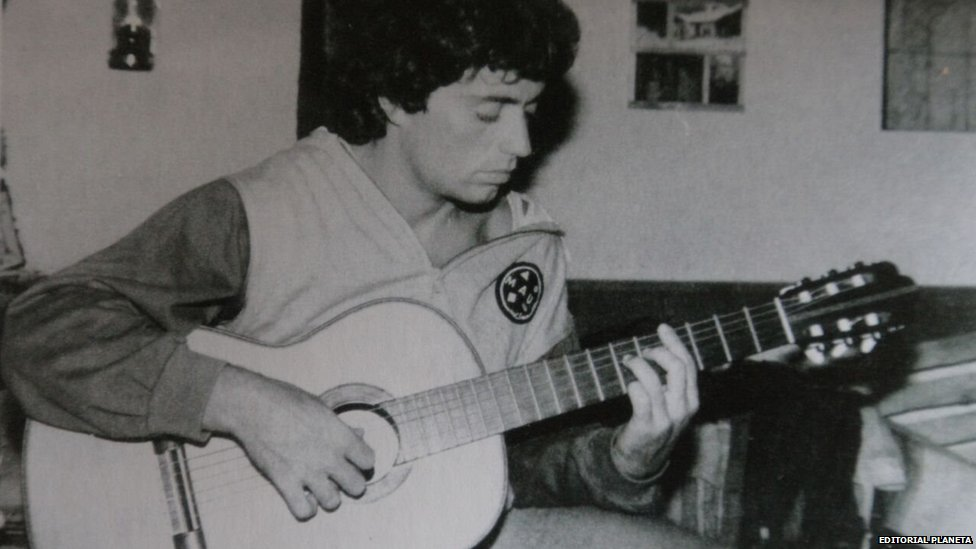 Undated picture of Alejandro Puccio playing the guitar