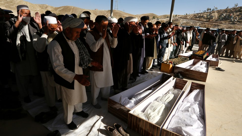 People attend at the funeral of victims after a landmine targeted a mini-bus full of passengers in a Taliban controlled area in Wardak province 40km away from Kabul, Afghanistan, 20 October 2020.