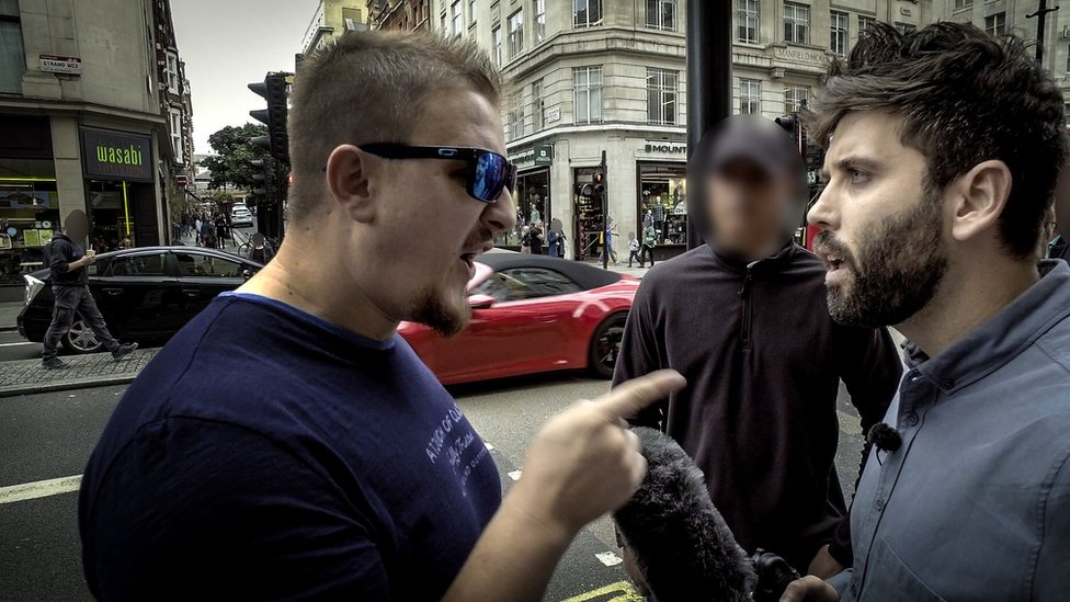 Screen grab from the documentary showing the reporter confronting Eddie