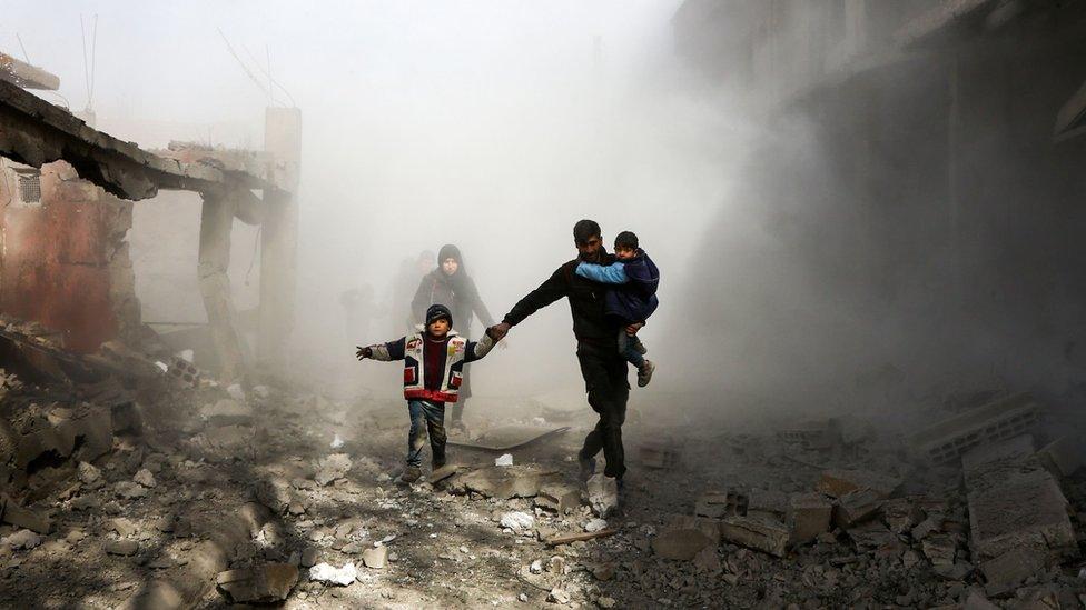 Syrian civilians flee from reported regime air strikes in the rebel-held town of Jisreen