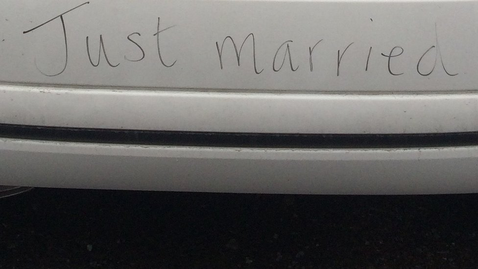 Just married written on rear bumper of car