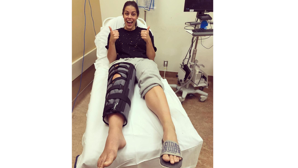 Ms Russo in hospital with her leg in a cast