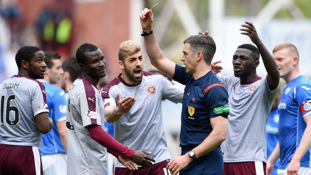 Hearts' Abiola Dauda (second from left) is shown a red card by Referee Greg Aitken