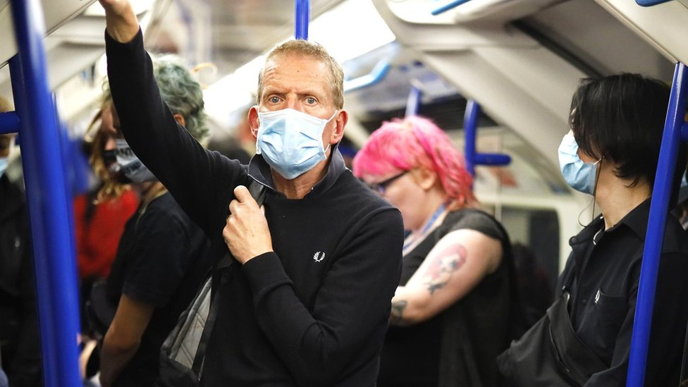 Man wearing a face mask on a London Undergrond train