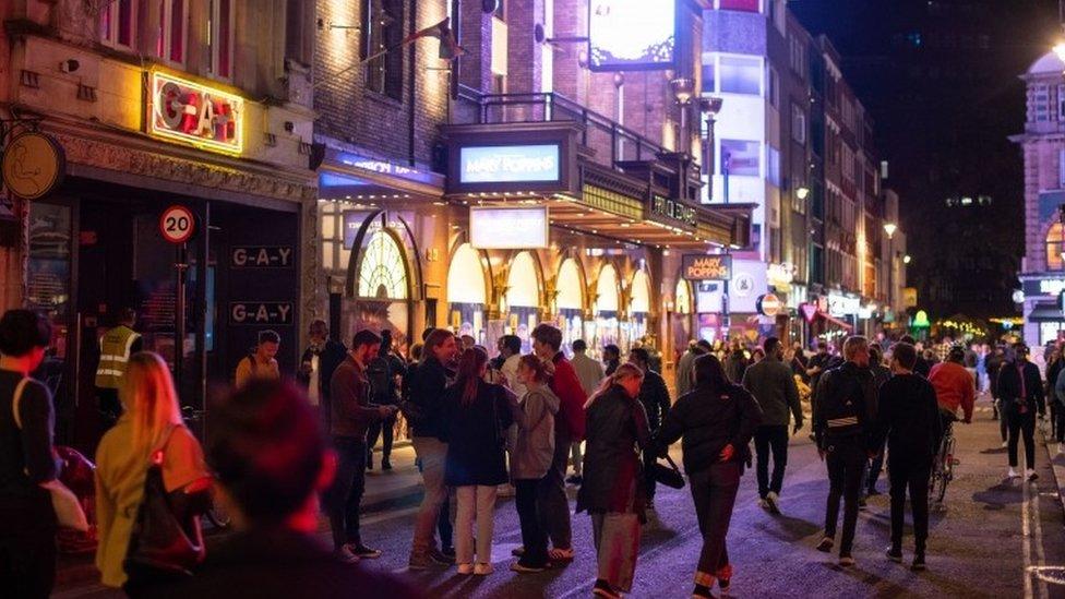 People gather outside G-A-Y nightclub following the 10pm curfew
