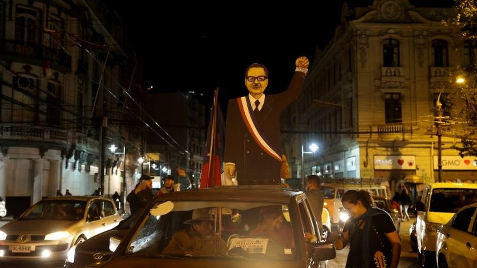 A cardboard figure depicting former Chilean President Salvador Allende is seen on the roof of a car after people voted during a referendum on a new Chilean constitution, in Valparaiso, Chile October 25, 2020