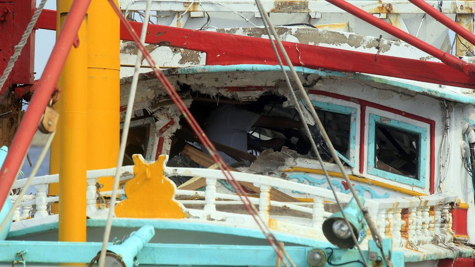 This handout photo taken and released by Taiwan's Central News Agency (CNA) shows a damaged fishing boat at a harbour in southern Tainan, on 1 July
