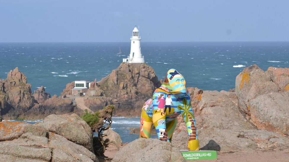 Gorilla statue in front of lighthouse